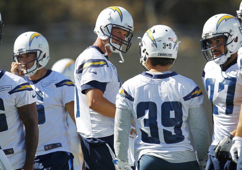 San Diego Chargers quarterback Philip Rivers talks with Danny Woodhead (39) during training camp.