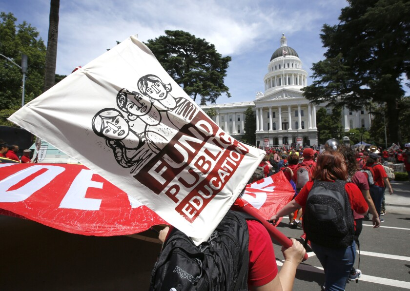 Members of the California Teachers Association and supporters of public education marched to the Cap