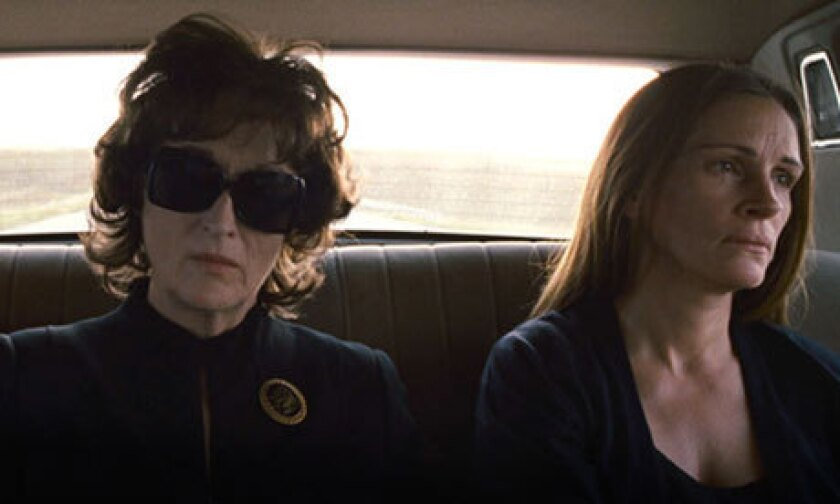 """Meryl Streep and Julia Roberts in one of the happier moments from """"August: Osage County."""""""