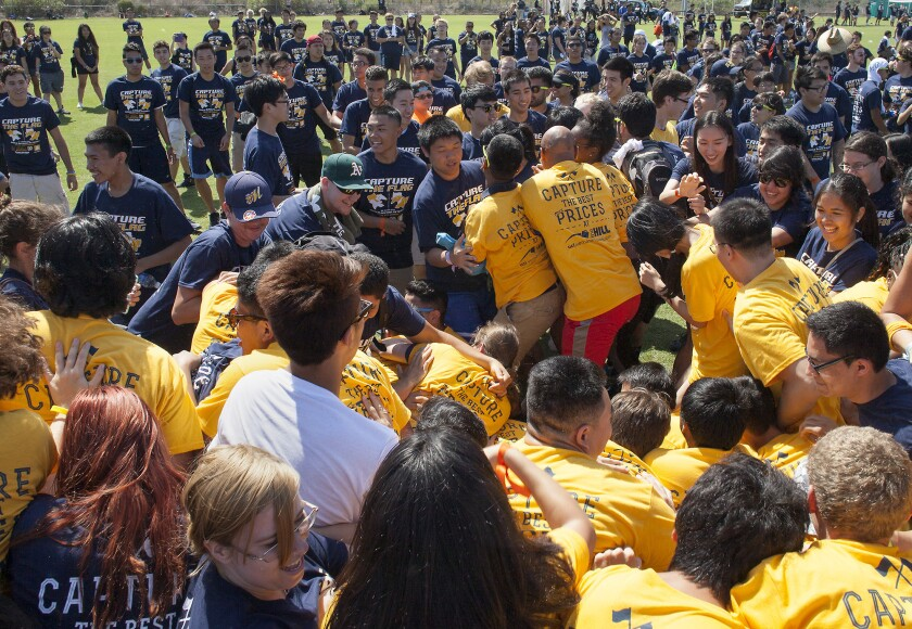 Gold team members attempt to push past members of the the blue team as UC Irvine students break a world record for the largest game of capture the flag at Anteater Recreation Center fields on Tuesday. UC Irvine set a new world record with 2,888 participants.