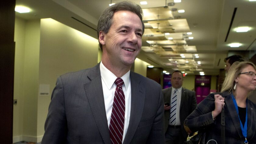 FILE -In this Feb. 23, 2019, file photo, Montana Gov. Steve Bullock walks to a meeting during the Na