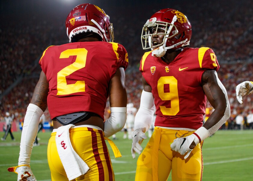 USC defenders Olaijah Griffin, left, and Greg Johnson.
