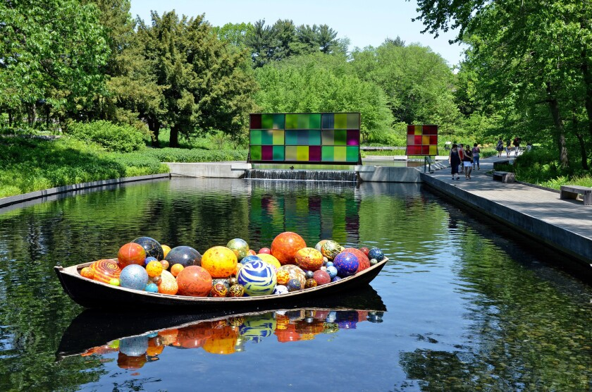 Dale Chihuly's 'Float Boat' filled with glass balls is in the native plant garden of the NYBG in the