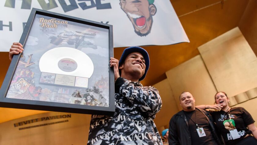 "Anderson .Paak holds his gold plaque for his single ""Bubblin."""