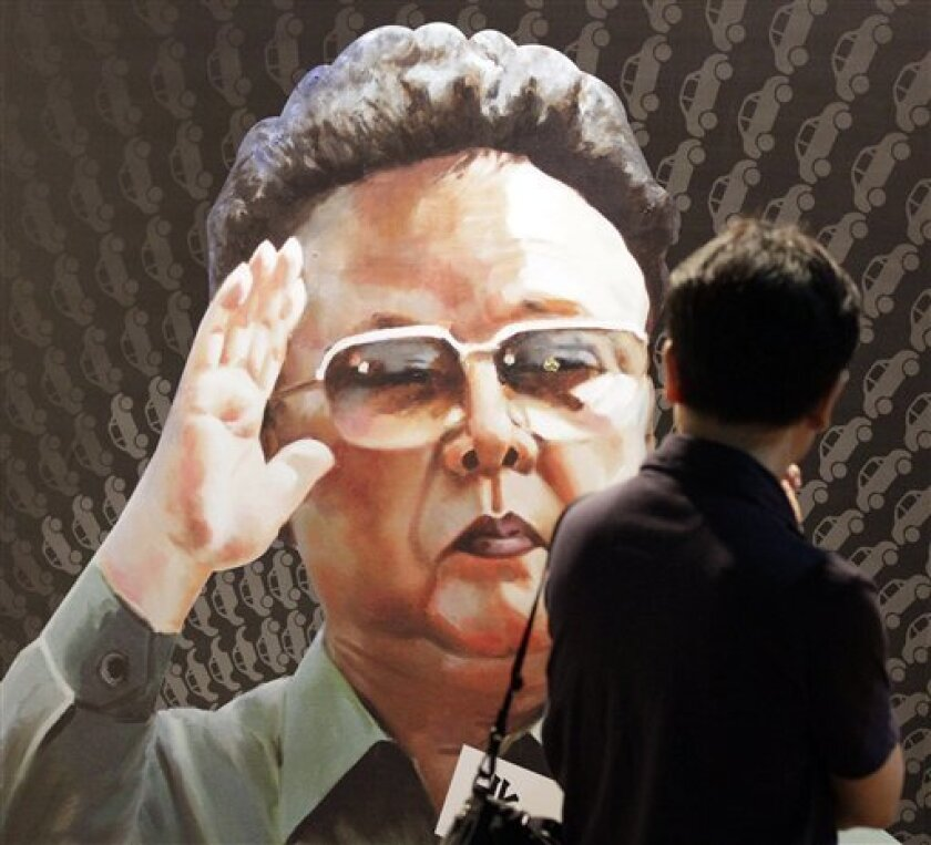 A tourist looks at a poster of North Korean leader Kim Jong Il, painted by North Korean defector Sun Moo, at the Korea War Memorial Museum in Seoul, South Korea, Tuesday, Sept. 7, 2010. North Korea requested a shipment of rice, cement and heavy equipment days after South Korea offered relief aid to its communist neighbor to help it recover from recent flooding, the Unification Ministry said Tuesday. (AP Photo/ Lee Jin-man)