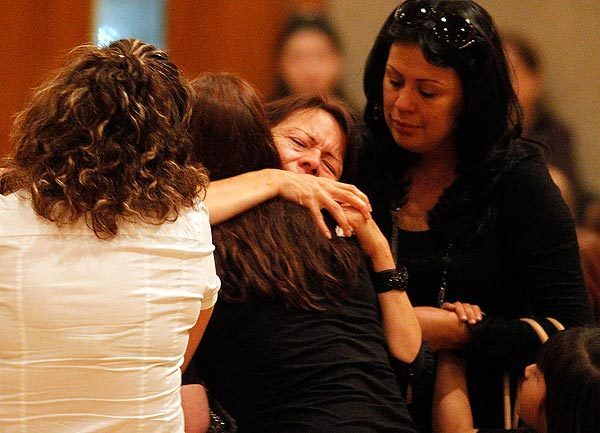 Family and friends comfort Margarita Meza, mother of Cindi Santana, during a South Gate memorial service for Cindi, a senior at South East High School who was stabbed to death on campus Sept. 30. Her ex-boyfriend, Abraham Lopez, 18, is in custody in the slaying. See full story