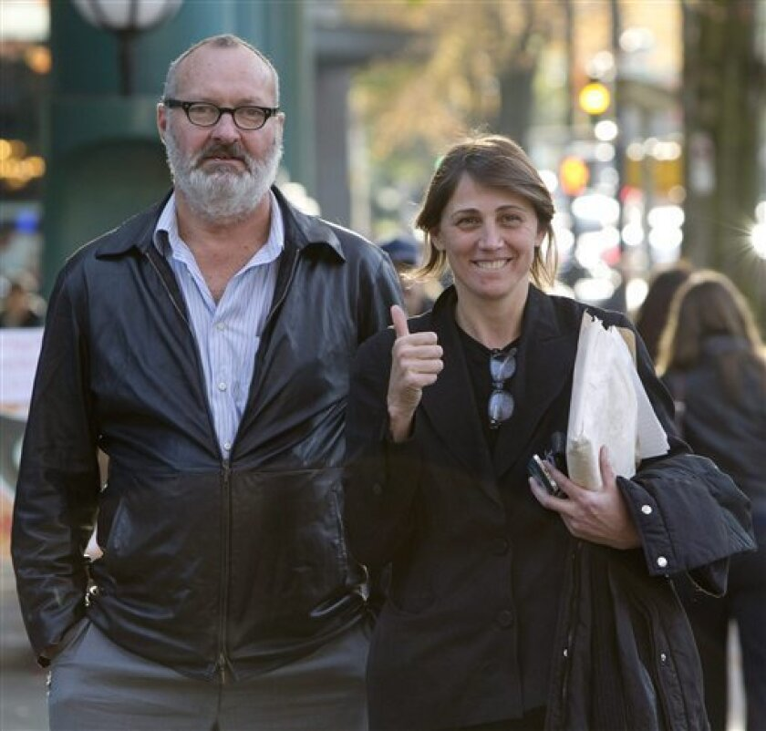 Actor Randy Quaid and his wife Evi are shown outside their lawyer's office in Vancouver, on Wednesday, Oct. 27, 2010. Quaid and his wife Evi have been released from a Canadian detention facility after she was declared a Canadian citizen. The Quaids were arrested last week in a shopping area of a posh Vancouver, British Columbia, neighborhood and were jailed on outstanding U.S. warrants related to vandalism charges. (AP Photo/The Canadian Press, Jonathan Hayward)
