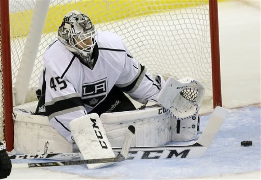 Los Angeles Kings goalie Jonathan Bernier makes a save during the third period of an NHL hockey game against the Dallas Stars in Dallas on Sunday March 31, 2013. (AP Photo/Mike Fuentes)