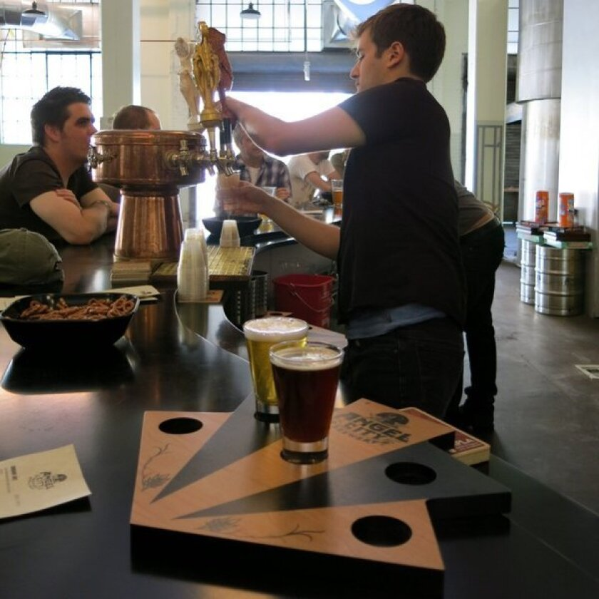 Pulling beers from the tap at Angel City Brewery.