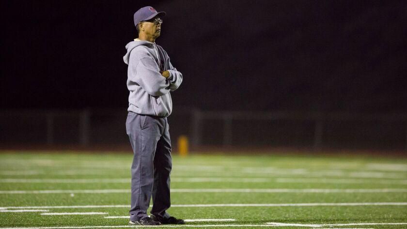 Monte Vista head coach Ron Hamamoto looks on during pregame warmups.