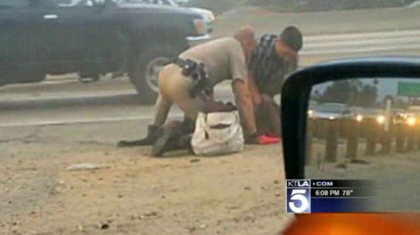 Woman videotaped in CHP beating was walking into traffic, report
