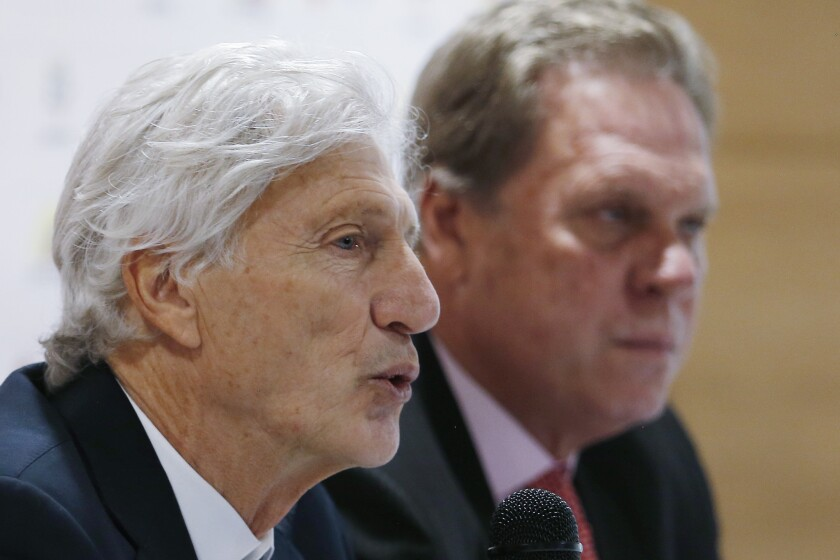 Coach Jose Pekerman announces his resignation as head coach of Colombia's national soccer team at a press conference in Bogota, Colombia, Tuesday, Sept. 4, 2018. Pekerman led Colombia to the 2014 and 2018 World Cups. Pictured right is Colombia Football Federation President Ramon Jesurun.