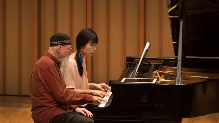 Terry Riley and Gloria Cheng at the Piano Spheres concert Tuesday at the Zipper Concert Hall at the Colburn School in Los Angeles.