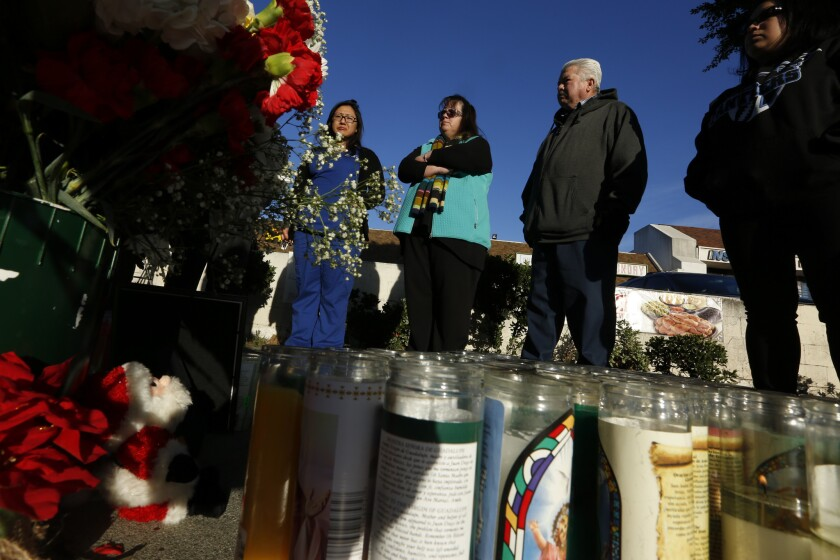 LOS ANGELES ,CA., DECEMBER 16, 2015: Mourners gather at the roadside memorial near Avenue 60 and Fig