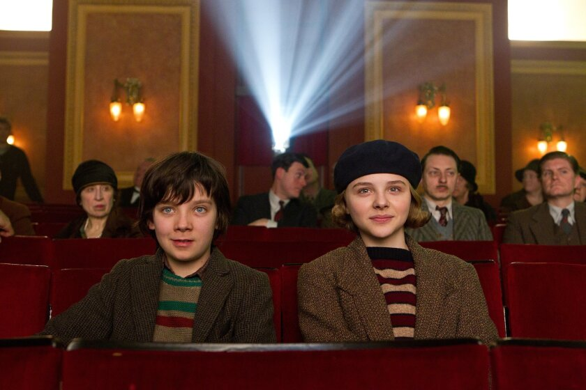 Left to right: Asa Butterfield plays Hugo Cabret and Chloe Grace Moretz plays Isabelle in HUGO, from Paramount Pictures and GK Films.