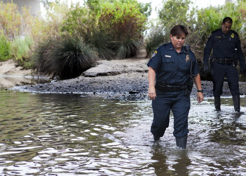 Lt. Natalie Stone visits the San Diego River last year as part of an effort to work with other agencies on homeless issues. [U-T file]