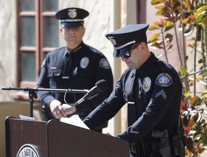 Corporal Zachary Fillers, right, of the Laguna Beach Police Department shares memories of Officer K9 Ranger.