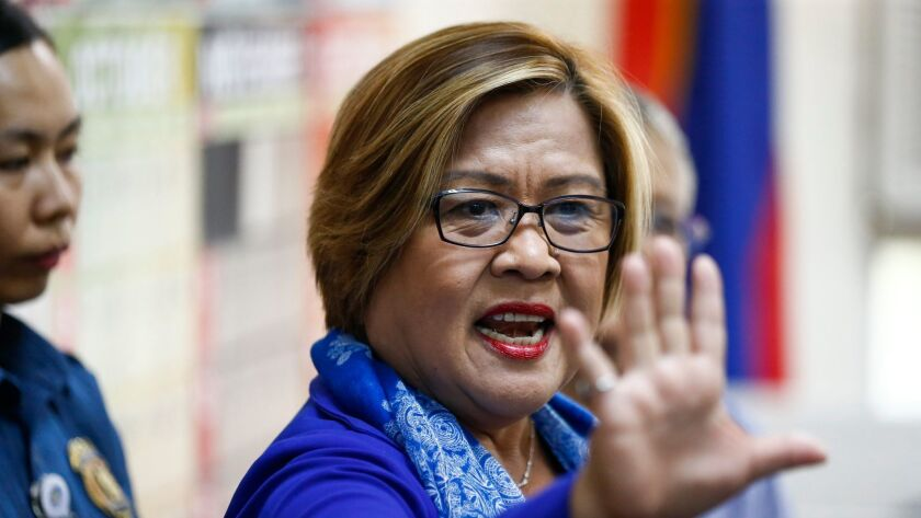 Philippine Sen. Leila De Lima gestures after arriving at a metropolitan trial court for her arraignment in Quezon City, east of Manila, on March 13, 2017.
