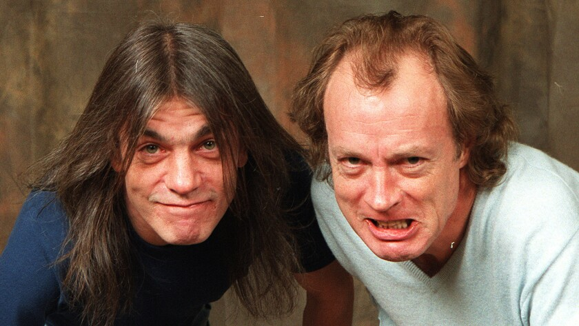 Malcolm Young, left, with brother and AC/DC bandmate Angus Young, has dementia, his family confirmed to People on Tuesday.