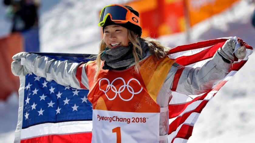 Chloe Kim, of the United States, celebrates winning gold after the women's halfpipe finals at Phoeni
