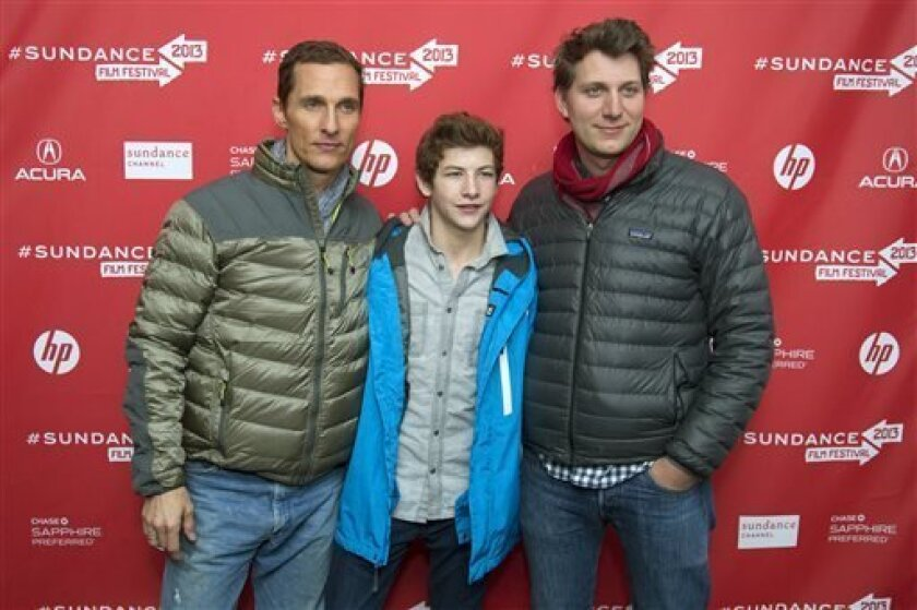 "FILE - This Jan. 19, 2013 file photo shows director Jeff Nichols, right, with actors Matthew McConaughey, left, and Tye Sheridan at the premiere of their film, ""Mud"" during the 2013 Sundance Film Festival in Park City, Utah.  In his latest, ""Mud,"" Nichols takes another step upward in scale, fashion"