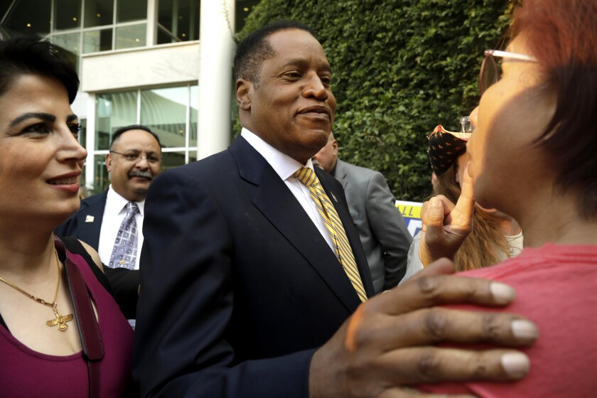 Republican candidate for governor Larry Elder greets supporters in Woodland Hills on Aug. 10.