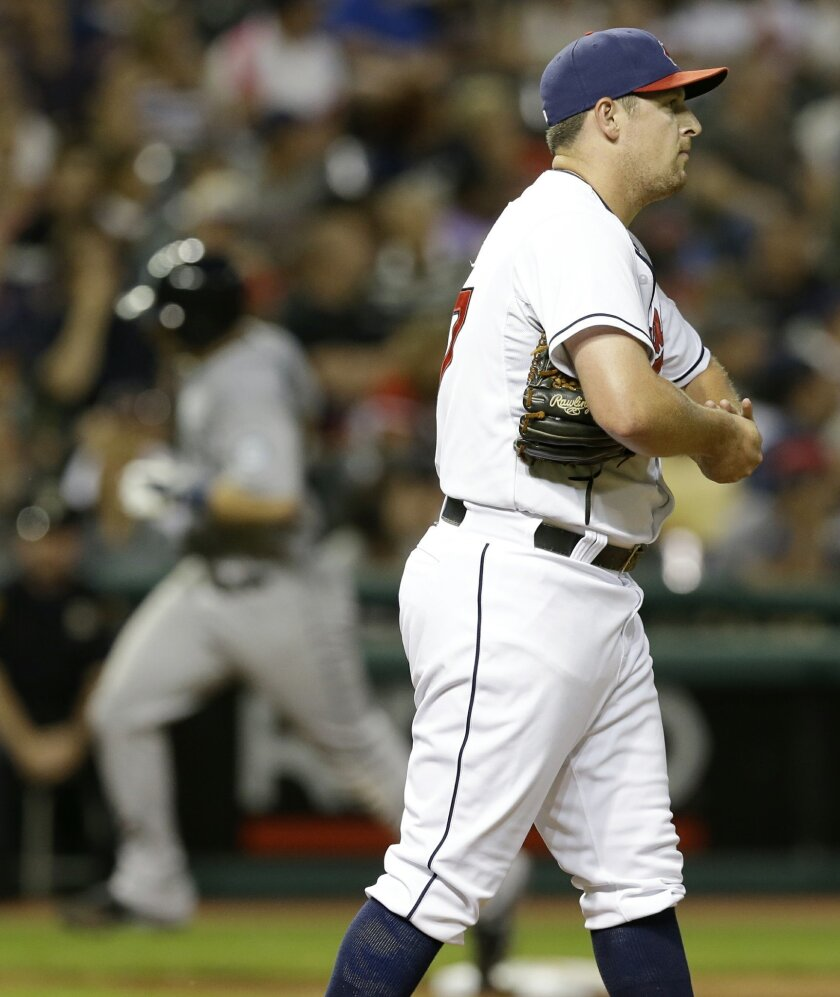 Cleveland Indians relief pitcher Bryan Shaw, right, waits for Seattle Mariners' Mike Zunino, left, to run the bases after Zunino hit a two-run home run in the eighth inning of a baseball game Thursday, July 31, 2014, in Cleveland. Kyle Seager scored on the play. (AP Photo/Tony Dejak)