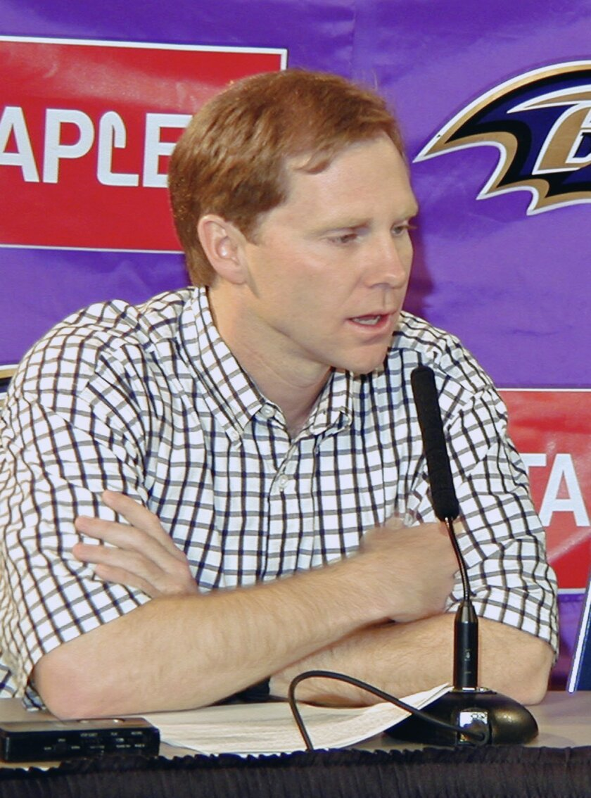 ADVANCE FOR WEEKEND EDITIONS, APRIL 18-19 -  FILE - In this April 21, 2001,  file photo, Phil Savage, then director of college scouting for the Baltimore Ravens and now the executive director of the Senior Bowl, speaks during the NFL draft in Owings Mill, Md. Back in the late 1990s, when Phil Savag
