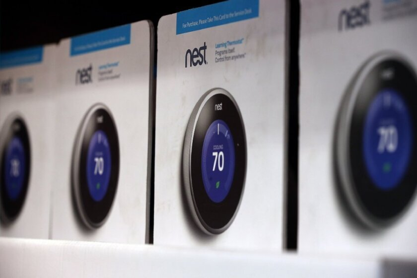 The Nest thermostat is displayed at a Home Depot store.