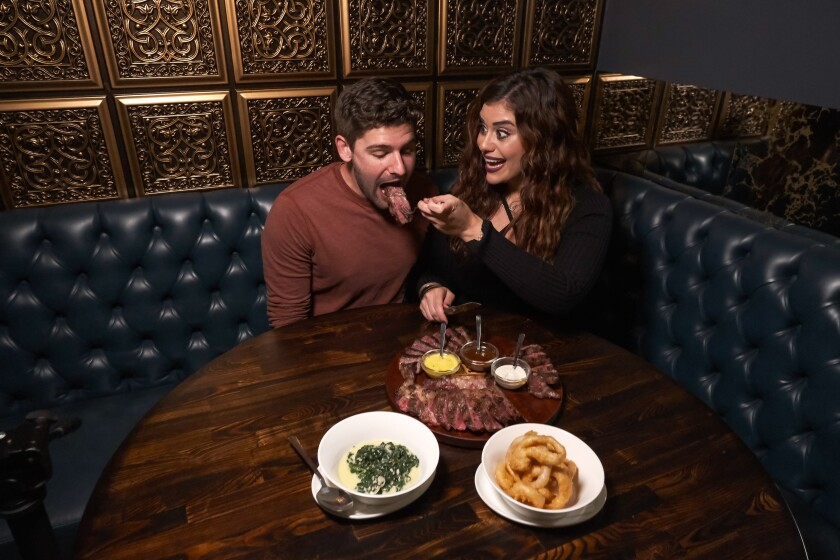 (From left to right) Correy opens up as Jasmine feeds her blind date a large piece of meat at Rare Society in Hillcrest where the two enjoyed a carnivorous dinner.