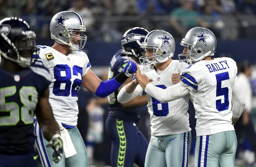 Seattle Seahawks' Kevin Pierre-Louis (58) walks away as Dallas Cowboys' Jason Witten (82) and Chris Jones (6) congratulate Dan Bailey (5) on his field goal kick in the second half of an NFL football game Sunday, Nov. 1, 2015, in Arlington, Texas. (AP Photo/Michael Ainsworth)
