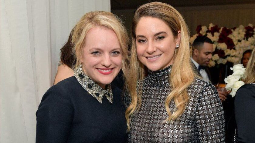 Actors Elisabeth Moss, left, and Shailene Woodley attend the InStyle and Warner Bros. after-party Sunday at the Beverly Hilton Hotel in Beverly Hills.