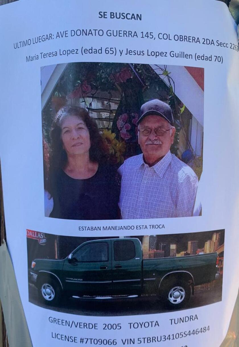 A poster shows Jesus Lopez Guillen, 70, and wife Maria Teresa Guillen, 65.