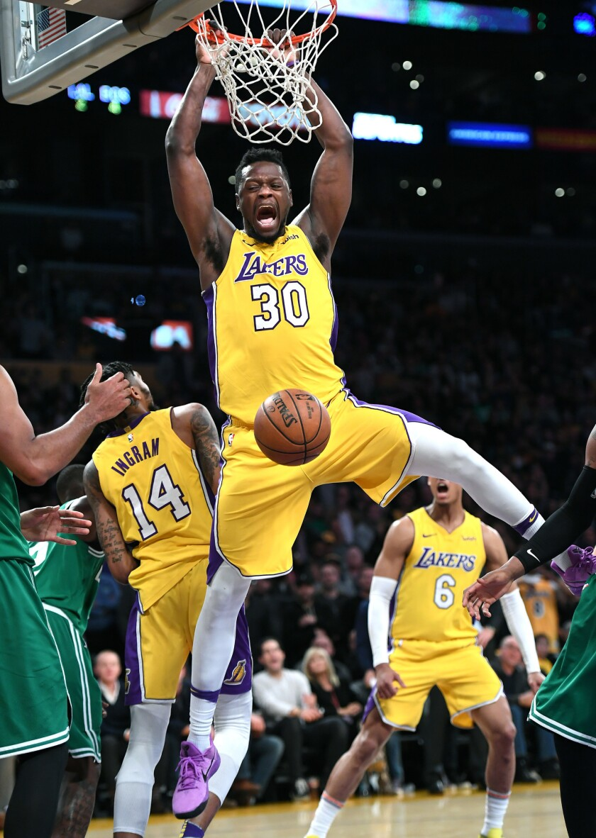 Lakers forward Julius Randle dunks the ball during the fourth quarter of a game Tuesday at Staples Center.