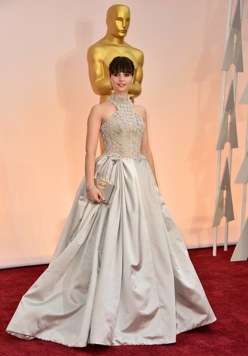 Felicity Jones arrives at the Oscars on Sunday, Feb. 22, 2015, at the Dolby Theatre in Los Angeles. (Photo by Jordan Strauss/Invision/AP)
