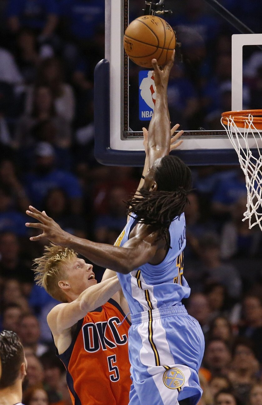Denver Nuggets forward Kenneth Faried (35) blocks a shot by Oklahoma City Thunder forward Kyle Singler (5) in the first half of an NBA basketball game in Oklahoma City, Sunday, Nov. 1, 2015. (AP Photo/Sue Ogrocki)