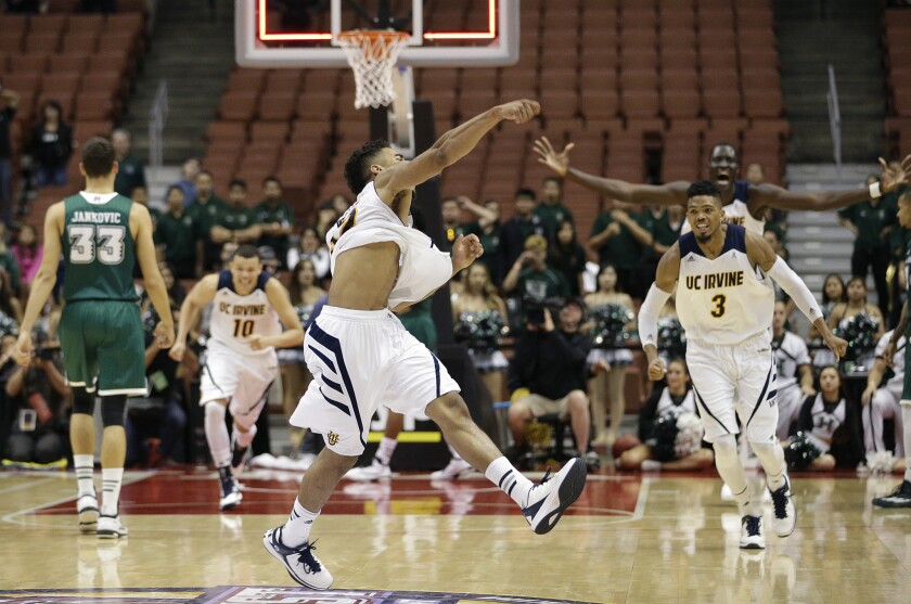UC Irvine's Aaron Wright, center, celebrates the team's 67-58 win over Hawaii in the Big West tournament championship game on Saturday night.