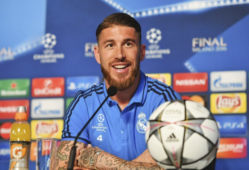 In this photo provided by UEFA, Real Madrid's Sergio Ramos smiles during a press conference at the San Siro stadium in Milan, Italy, Friday, May 27, 2016. The Champions League final soccer match between Real Madrid and Atletico Madrid will be held at the San Siro stadium on Saturday, May 28. (UEFA