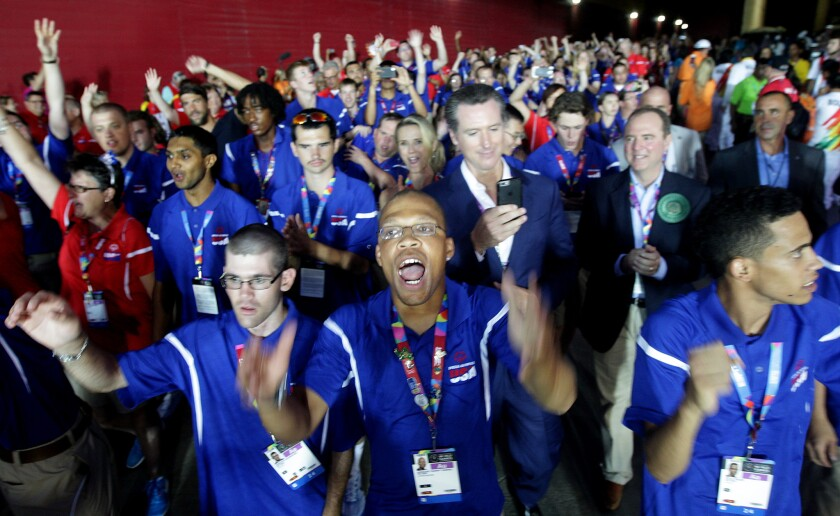 Members of the U.S. team walk into the stadium for the opening ceremony of the Special Olympics World Games on Saturday at the Coliseum.
