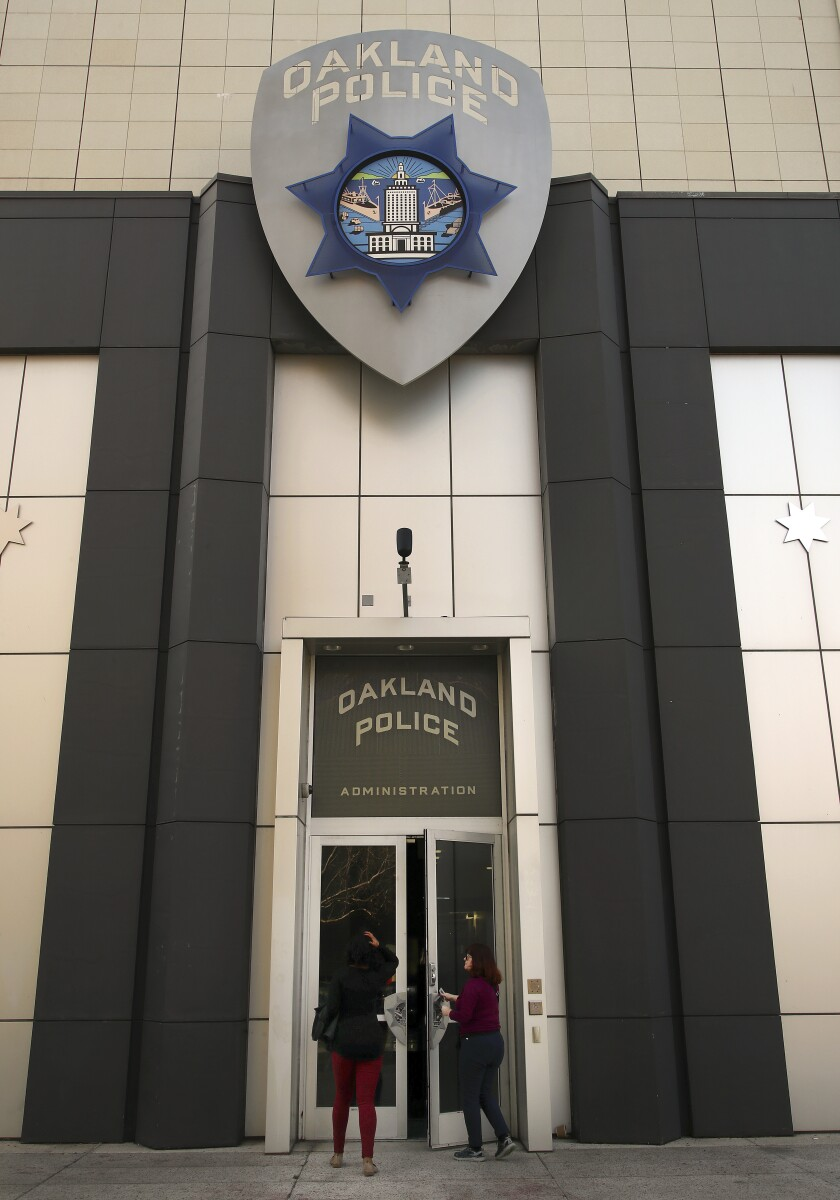 Women enter the Oakland Police Department in January 2018.