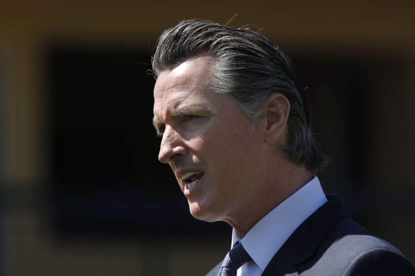 """Gov. Gavin Newsom said he used """"the purchasing power of the state of California"""" to procure masks for healthcare workers."""