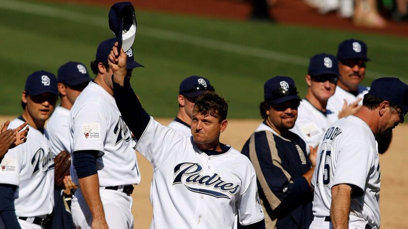 Padres pitcher Trevor Hoffman, center, tips his cap after getting the final out in the ninth inning against the Pittsburgh Pirates, Sunday, Sept. 24, 2006, in San Diego. Hoffman recorded his 479th career save in the Padres' 2-1 win, breaking the all-time career saves record.