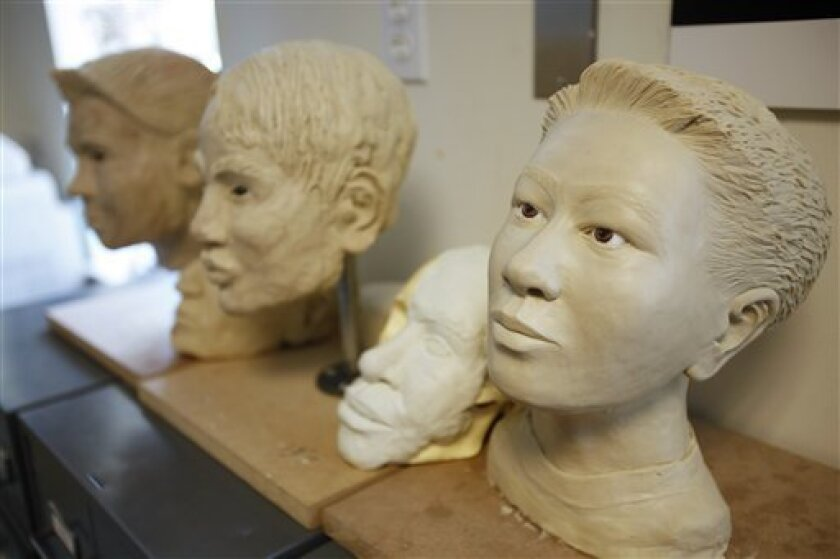 Age progression sculptures are seen at the National Center for Missing and Exploited Children in Alexandria, Va., on Wednesday, June 24, 2009. Computer analysts at the center investigate about 2,000 reports a week of suspected child pornography that come in from the public and online service providers. (AP Photo/Jacquelyn Martin)
