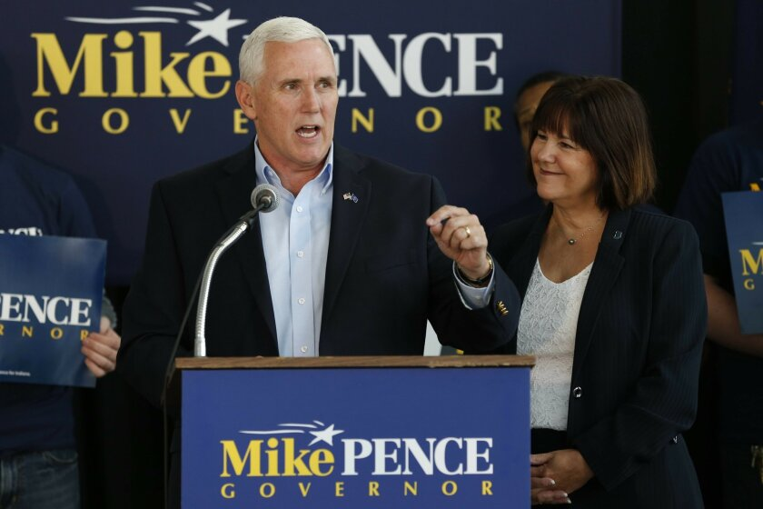 In this photo taken on Wednesday, May 11, 2016, Indiana Gov. Mike Pence launches his campaign for re-election during an event in Indianapolis. Pence is trying to pivot his focus from social issues to Indiana's improving economy as he faces a difficult re-election campaign. Under the Republican, Ind