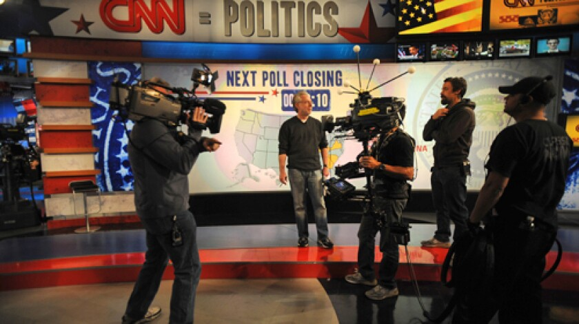 BUILDING EXCITEMENT: Anchor Wolf Blitzer, center, and CNN crew members rehearse. The network plans to use hologram technology on set.