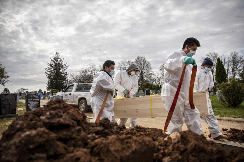 APTOPIX Virus Outbreak Burying the Dead