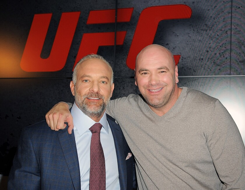 UFC President Dana White, right, and co-owner Lorenzo Fertitta attend a news conference announcing a sponsorship deal with Reebok in New York on Dec. 2, 2014.