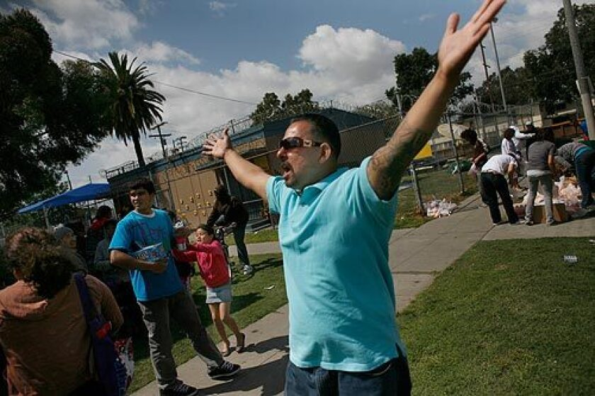 Alfred Lomas arrives at the Pueblo del Rio housing project in South Los Angeles. It is not so much the ex-gang members food program that has drawn the attention of civic leaders, but how he builds a renewed sense of community. Multimedia >>>
