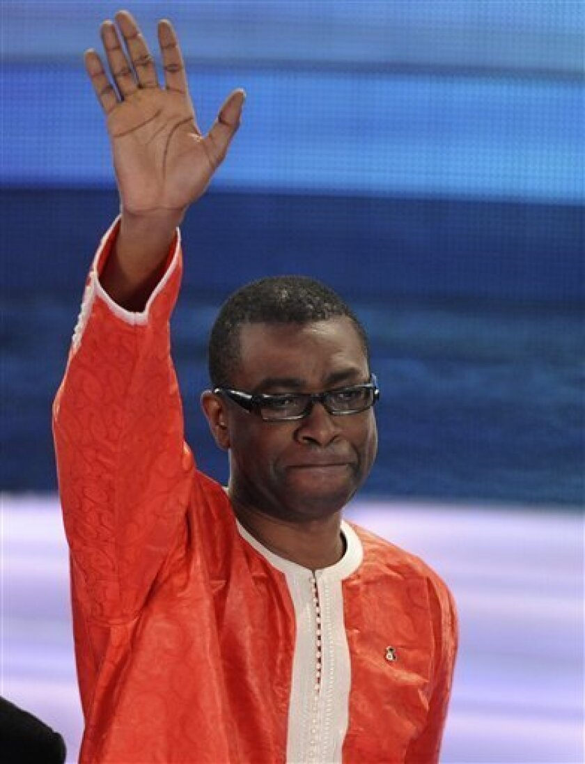 """In a Feb. 18, 2009 photo Senegalese singer and composer Youssou N'Dour performs during the """"Festival di Sanremo"""" Italian song contest, in San Remo, Italy. Ndour announced Monday Jan. 2, 2011 that he plans to run in Senegal's presidential election next month. (AP Photo/Alberto Pellaschiar)"""
