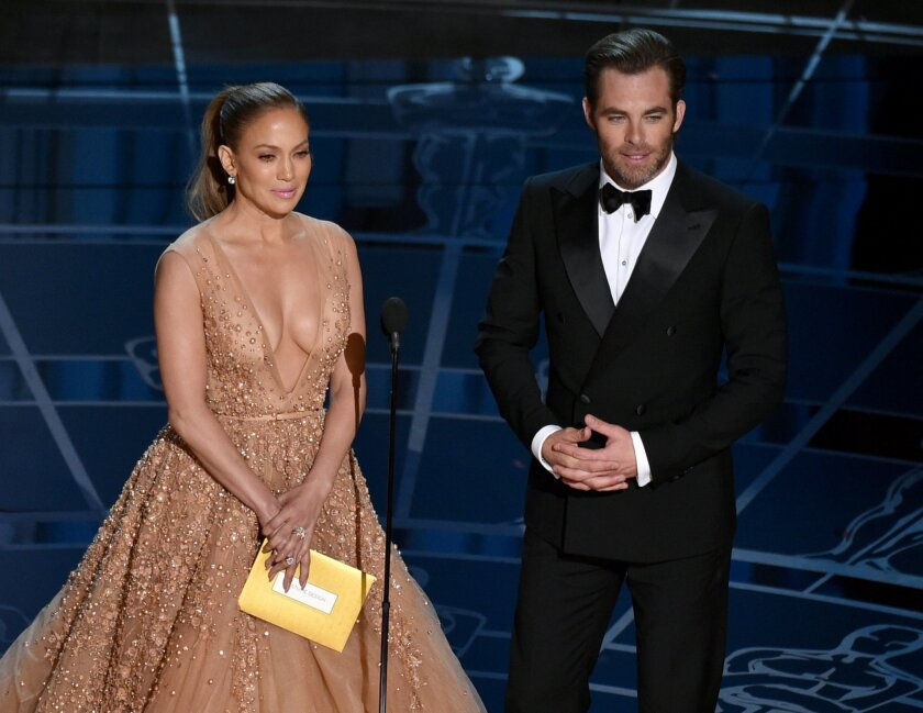 Jennifer Lopez, left, and Chris Pine present the award for best costume design at the Oscars on Sunday, Feb. 22, 2015, at the Dolby Theatre in Los Angeles. (Photo by John Shearer/Invision/AP)